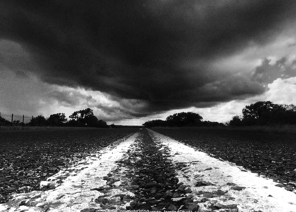 Road near Sisterdale, Texas as a brief storm approaches..