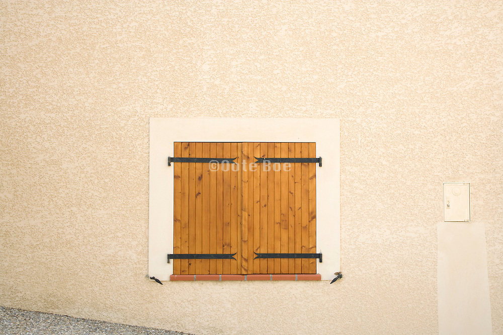 very low placed window with shutters closed