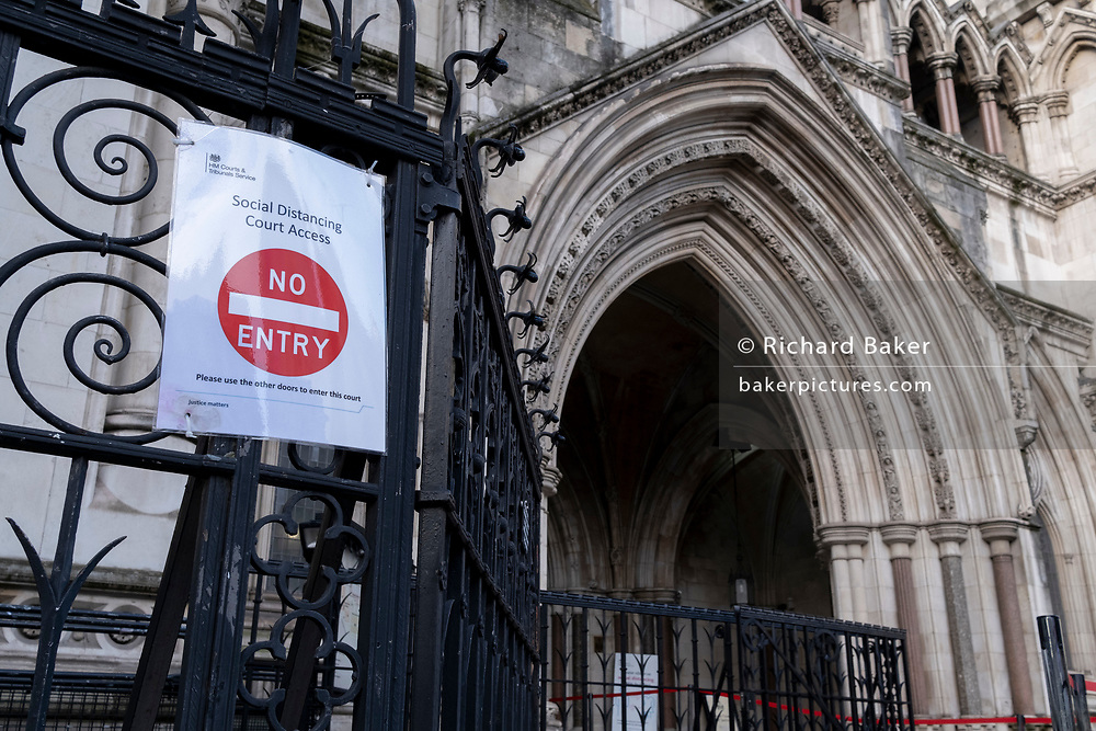 A No Entry sign has been placed on the railings outside the Royal Courts of Justice (The High Court) outside the Royal Courts of Justice, during the third lockdown of the Coronavirus pandemic, on 2nd February 2021, in London, England. Judicial and legal proceedings have been put under great pressure during continued lockdowns with hearings and court cases severely delayed.