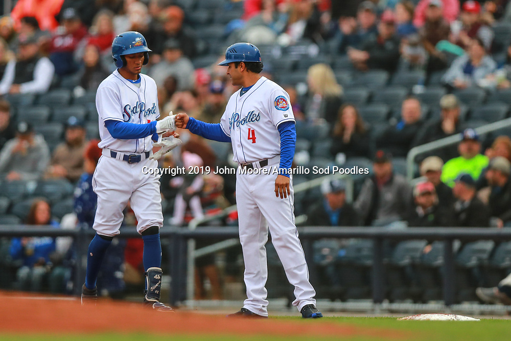 Amarillo Sod Poodles outfielder Edward Olivares (11) is met by fielding coach Freddy Flores after hitting the ball against the Springfield Cardinals on Sunday, Jan. 6, 2019, at HODGETOWN in Amarillo, Texas. [Photo by John Moore/Amarillo Sod Poodles]