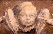 Painted cherub head angel inside Saint Nicholas chapel, Gipping, Suffolk, England, UK 18th century mural