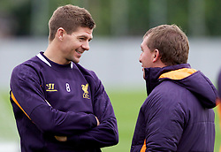 LIVERPOOL, ENGLAND - Wednesday, November 7, 2012: Liverpool's manager Brendan Rodgers talks to captain Steven Gerrard MBE during a training session at the club's Melwood Training Ground ahead of the UEFA Europa League Group A match against FC Anji Makhachkala. (Pic by Vegard Grott/Propaganda)