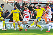 Niall Mason of Doncaster Rovers (2) drives with the ball through multiple Wimbledon players during the EFL Sky Bet League 1 match between Doncaster Rovers and AFC Wimbledon at the Keepmoat Stadium, Doncaster, England on 17 November 2018.