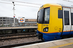 © Licensed to London News Pictures. 21/03/2019. London, UK.  An overground train travels through Hackney Wick overground station, which has reopened this morning. Two people were found dead on the Overground Railway track between Stratford and Hackney Wick last night.  Photo credit: Vickie Flores/LNP
