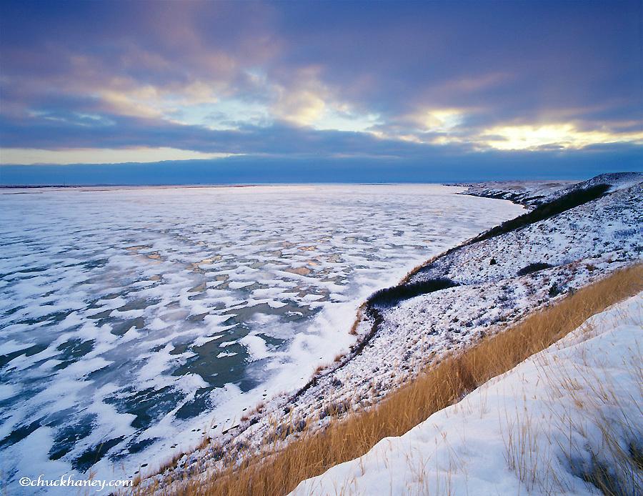 Frozen lake at sunrise at Medicine Lake NWR in Montana