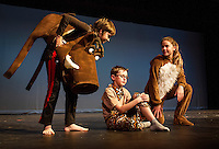 """Pumbaa (Sam Leggett) and Timon (Julie Auld) begin to explain """"Hakuna Matata"""" to Simba (Jesse Powers) during dress rehearsal for Gilford Middle School's production of """"The Lion King"""" on Monday afternoon.  (Karen Bobotas/for the Laconia Daily Sun)"""