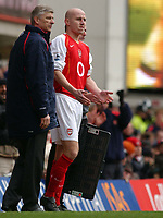 Photo. Daniel Hambury.<br /> Arsenal v Sheffield United. <br /> FA Cup Fifth Round.<br /> 19/2/2005.<br /> Arsenal's Pascal Cygan prepares to enter the game under the gaze of manager Arsene Wenger.
