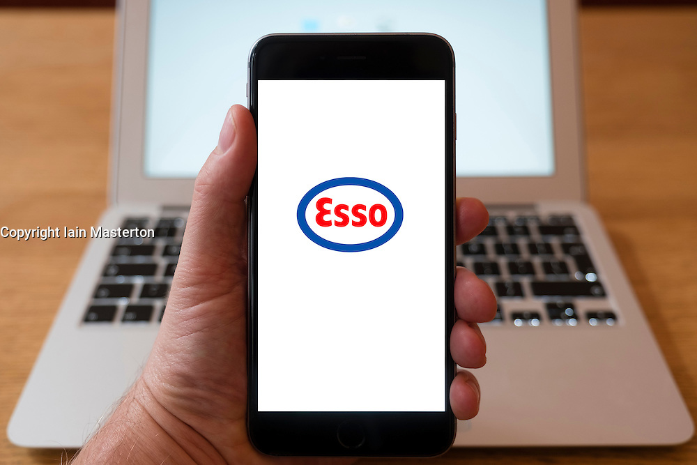 Using iPhone smartphone to display logo of Esso oil and gas company