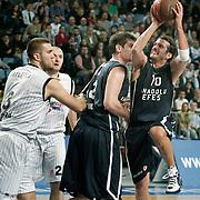 Anadolu Efes's Kerem TUNCERI (R) during their Turkish Airlines Euroleague Basketball Group C Game 6 match Anadolu Efes between Partizan at Sinan Erdem Arena in Istanbul, Turkey, Wednesday, November 23, 2011. Photo by TURKPIX