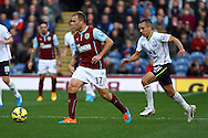 Burnley's Scott Arfield gets away from Everton's Leon Osman. Barclays Premier league match, Burnley v Everton at Turf Moor in Burnley, Lancs on Sunday 26th October 2014.<br /> pic by Chris Stading, Andrew Orchard sports photography.