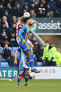 Stoke City  Sam Clucas (22) challenges  20 Aaron Holloway for Shrewsbury Town during the The FA Cup 3rd round match between Shrewsbury Town and Stoke City at Greenhous Meadow, Shrewsbury, England on 5 January 2019.