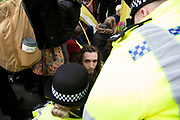 Police begin talking to and trying to clear climate change activists from the Extinction Rebellion group at Oxford Street near to the Marble Arch camp in protest that the government is not doing enough to avoid catastrophic climate change and to demand the government take radical action to save the planet, on 24th April 2019 in London, England, United Kingdom. Extinction Rebellion is a climate change group started in 2018 and has gained a huge following of people committed to peaceful protests.