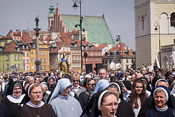 © Licensed to London News Pictures. 26/04/2016. Warsaw, Poland. Nuns taking part in a procession through Warsaw's Old Town in commemoration Corpus Christi (Boze Cialo). Corpus Christi (Body of Christ) is a Catholic feast celebrated as a national public holiday in Poland. It is the day when the Catholic Church commemorates the practice of Holy Eucharist, or Communion. Photo credit: Rob Arnold/LNP