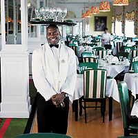 Jamaican Restaurant server readies the tables in photo by Architectural Lifestyle Photographer Wayne Cable, Grand Hotel. Mackinac Island Michigan for Coastal Living Magazine.<br /> <br /> Copyright 2003 Wayne Cable.All rights reserved
