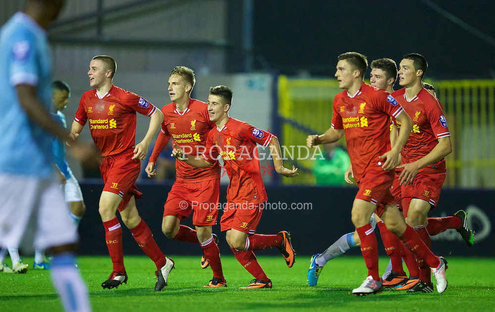 MANCHESTER, ENGLAND - Monday, September 23, 2013: Liverpool's Cameron Brannagan celebrates scoring the second goal against Manchester City during the Under 21 FA Premier League match at Ewen Fields. (Pic by David Rawcliffe/Propaganda)