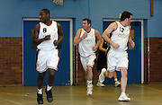 Erkenwald's Martin Overare (#8), Declan McCusker (middle) and Richard Williams (#12) run down court during Erkenwald's EMBL gagme at Eastbury Tigers on Thursday 9th February. This was Tigers' last home game at the Dawson Avenue gym since the School was closing the following day.