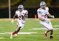 AC Flora Falcons running back Matt Pack (21) rushes against the North Myrtle Beach Chiefs during the first half the state championship game at Benedict College.