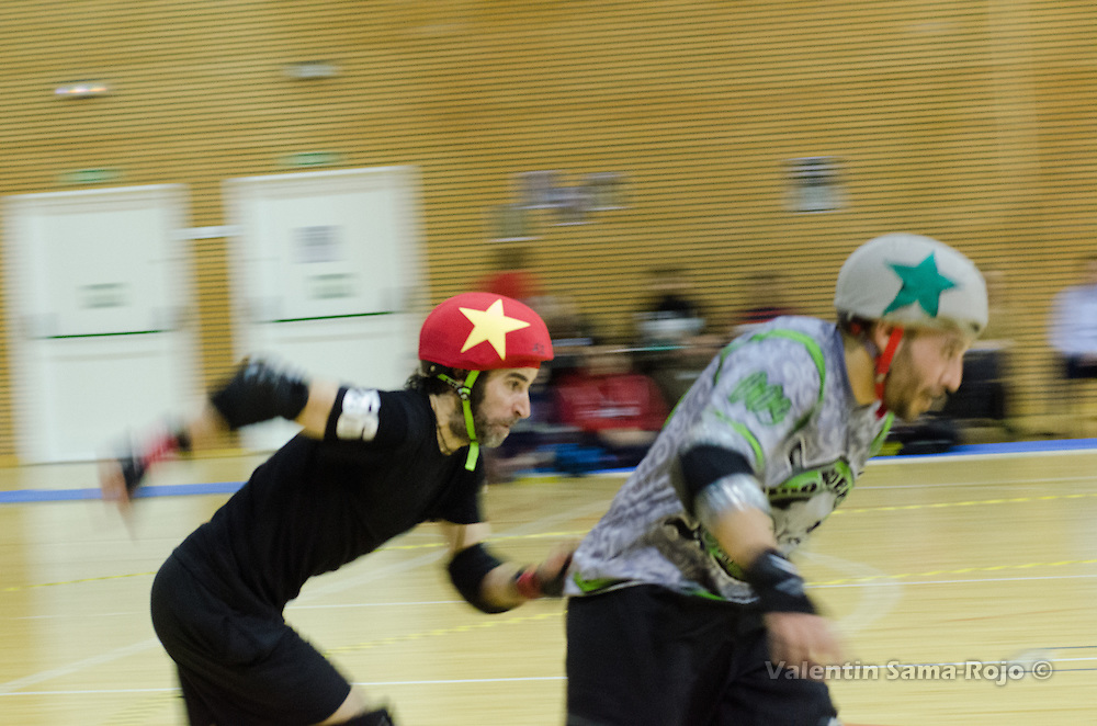 MADRID, SPAIN - January 23, 2016: Jammer of RockNRollaz (L), 56 Pere Ballari, sprinting near the jammer of MadRiders (R), 009 Ra, during the match held in Madrid.