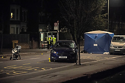 © Licensed to London News Pictures. 14/01/2019. Anerley, UK. Police at the scene, pushchair sits in the road and a blue car which has a smashed windscreen. A mother has been killed and a child is in hosptial fighting for life after being hit by a car crossing the road in Anerley near Penge.<br />   Photo credit: Grant Falvey/LNP