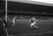 05/02/1967<br /> 02/05/1967<br /> 5 February 1967<br /> National Hurling League: Cork v Dublin at Croke Park, Dublin. <br /> Dublin goalie, G. Murray (left) saves a high ball with his right hand, as Dublin full back, P. Corcoran (second from the right), holds off Cork forward, C. Sheehan.