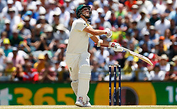 Australia's Pat Cummins plays a shot during day four of the Ashes Test match at the WACA Ground, Perth.