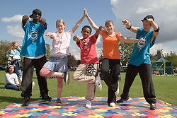 Dance teachers showing a group of children some street dance moves at a Parklife summer activities event,