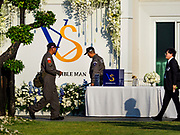 "04 NOVEMBER 2018 - BANGKOK, THAILAND: Royal Thai Police do a security sweep before the funeral of Vichai Srivaddhanaprabha at Wat Debsirin on the second day of funeral rites for Vichai. The VS are his initials. The ""Possible Man"" reflects Vichai's legacy in Leicester because he was viewed as the man who made everything possible after Leicester won the 2015-16 Premier League Championship. Vichai was the owner of King Power, a Thai duty free conglomerate, and the Leicester City Club, a British Premier League football (soccer) team. He died in a helicopter crash at the King Power stadium in Leicester after a match on October 27. Vichai was Thailand's 5th richest man. The funeral is expected to last one week.   PHOTO BY JACK KURTZ"