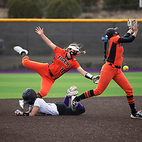 Miyamura Patriot Taniel Espinosa (6) is called out at second base for interference as Aztec Tigers pitcher Nizhoni Yellow (20) and second baseman Reagan Bradshaw (10) attempt to catch a fly ball in the bottom of the fifth inning Wednesday in Gallup.