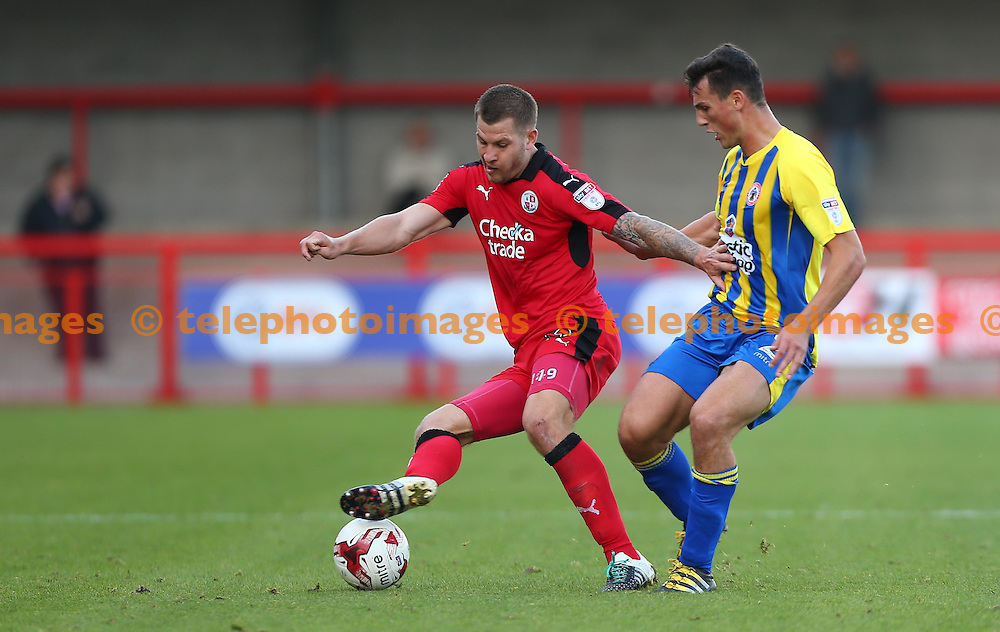 Crawley's James Collins vies with Matty Pearson of Accrington during the Sky Bet League 2 match between Crawley Town and Accrington Stanley at the Checkatrade Stadium in Crawley. October 22, 2016.<br /> James Boardman / Telephoto Images<br /> +44 7967 642437