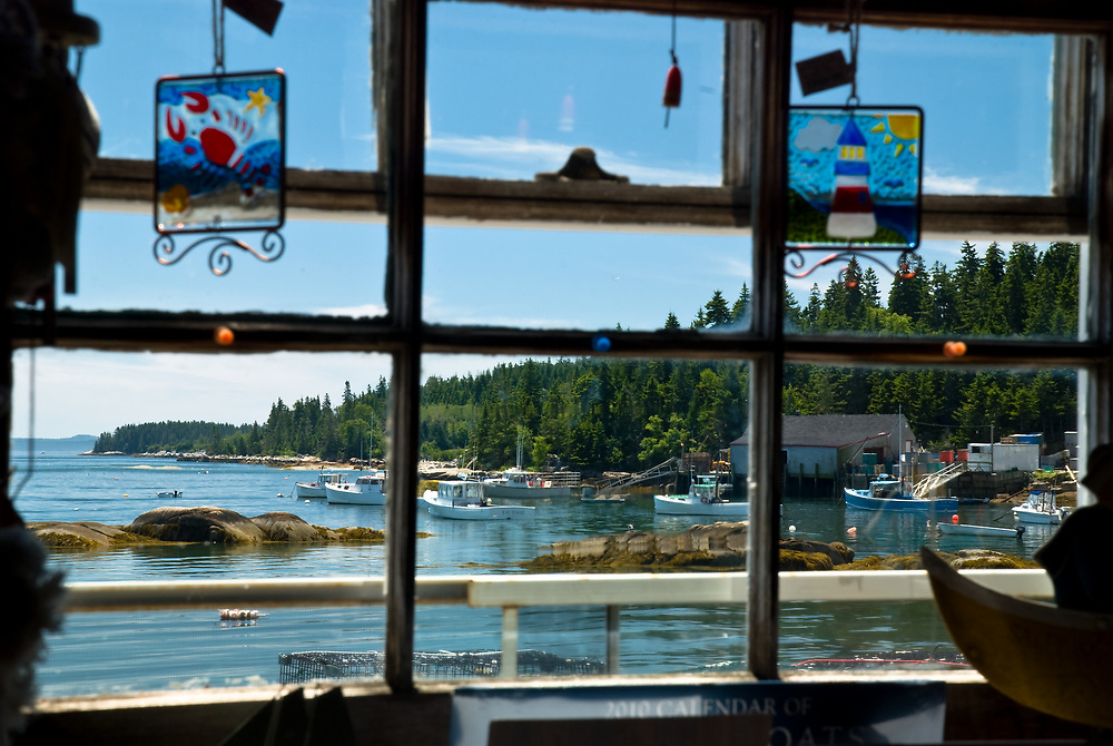 Here is an inviting view of Stonington harbor out the window of one of the numerous shops along the main street. Stonington has a substantial fleet of fishing boats, docks and  lobster pounds. Schooners frequently visit on their cruises or to pick up passengers.