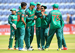 Bangladesh's Mosaddek Hossain (centre right) celebrates after taking the wicket of New Zealand's James Neesham during the ICC Champions Trophy, Group A match at Sophia Gardens, Cardiff.