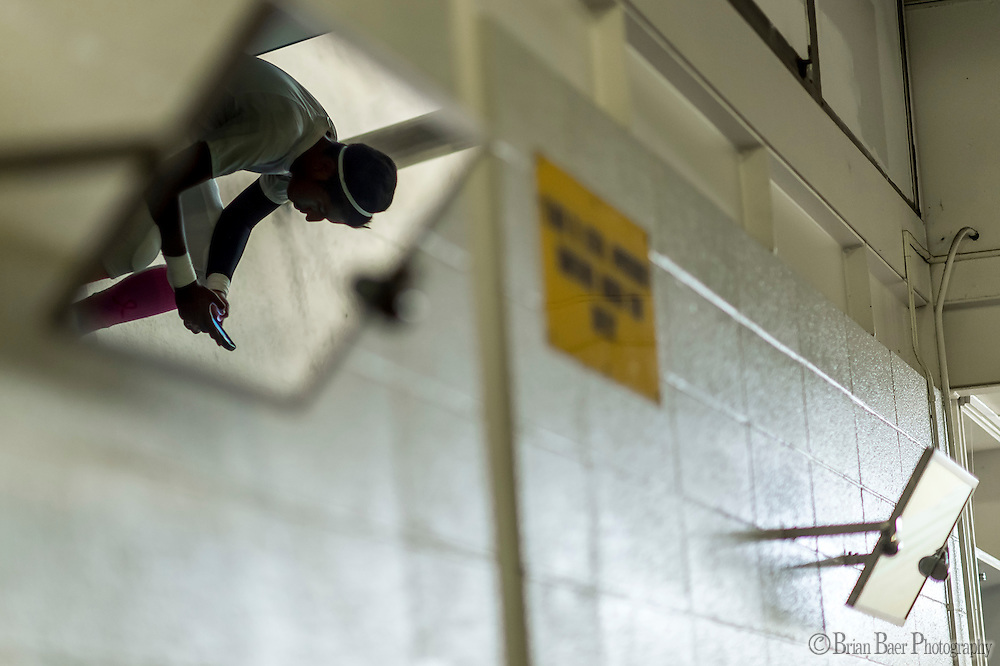 El Camino Eagles Tizoc Avendano (55), gets ready inside the locker room before the game as the El Camino Eagles host the Rio Americano Raiders at Del Campo High School, Friday Oct 7, 2016. <br /> photo by Brian Baer