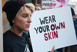 London, December 6th 2014. Tens of thousands throng the streets of London as shoppers take advantages of ongoing deals and discounts offered by retailers in the run-up to Christmas. PICTURED: A protester outside Benetton's Oxford Circus store demonstrates against the use of rabbit fur by the clothing giant.