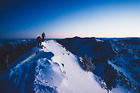 Caroline Gleich and Rob Lea hike the wintery east ridge of Mt Superior in the early morning twilight, Wasatch Backcountry.