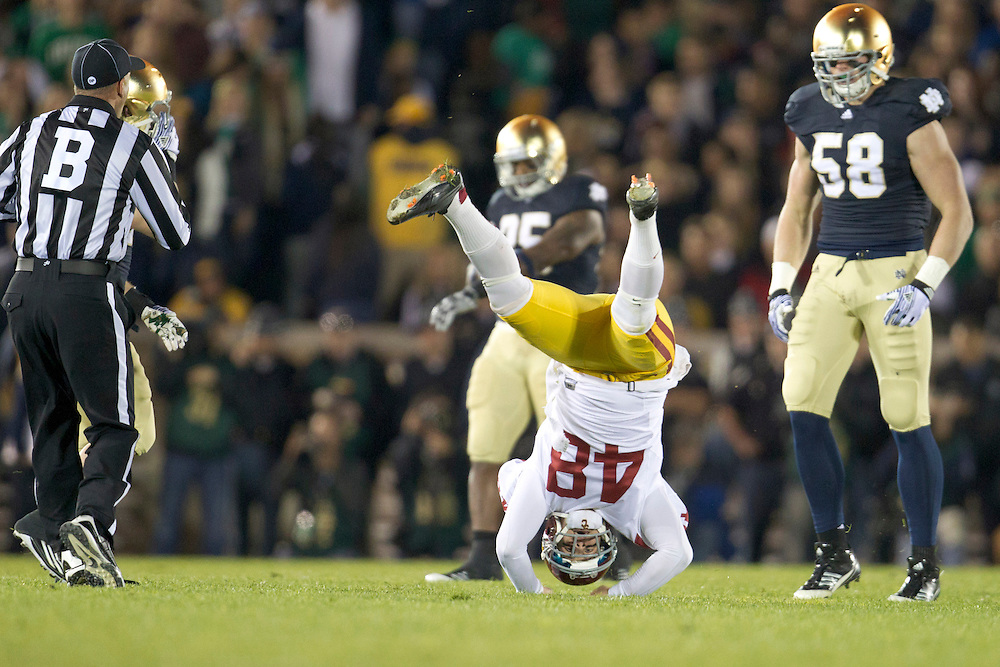 USC place kicker Andre Heidari (#48) gets upended on kickoff by Notre Dame outside linebacker Troy Niklas (#58) during NCAA football game between Notre Dame and USC.  The USC Trojans defeated the Notre Dame Fighting Irish 31-17 in game at Notre Dame Stadium in South Bend, Indiana.