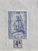 Azulejo tile ceramic image of guardian angel above house door, village of Alvito, Baixo Alentejo, Portugal, southern Europe