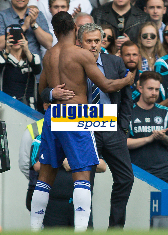 Football - 2014 / 2015 Premier League - Chelsea vs. Sunderland.   <br /> <br /> José Mourinho, Manager, of Chelsea FC hugs Chelsea's Didier Drogba as he leaves the pitch on his last appearance for Chelsea at Stamford Bridge <br /> <br /> COLORSPORT/DANIEL BEARHAM