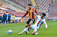 Devarm Green Tackles Levi Sutton during the EFL Sky Bet League 2 match between Bradford City and Scunthorpe United at the Utilita Energy Stadium, Bradford, England on 1 May 2021.