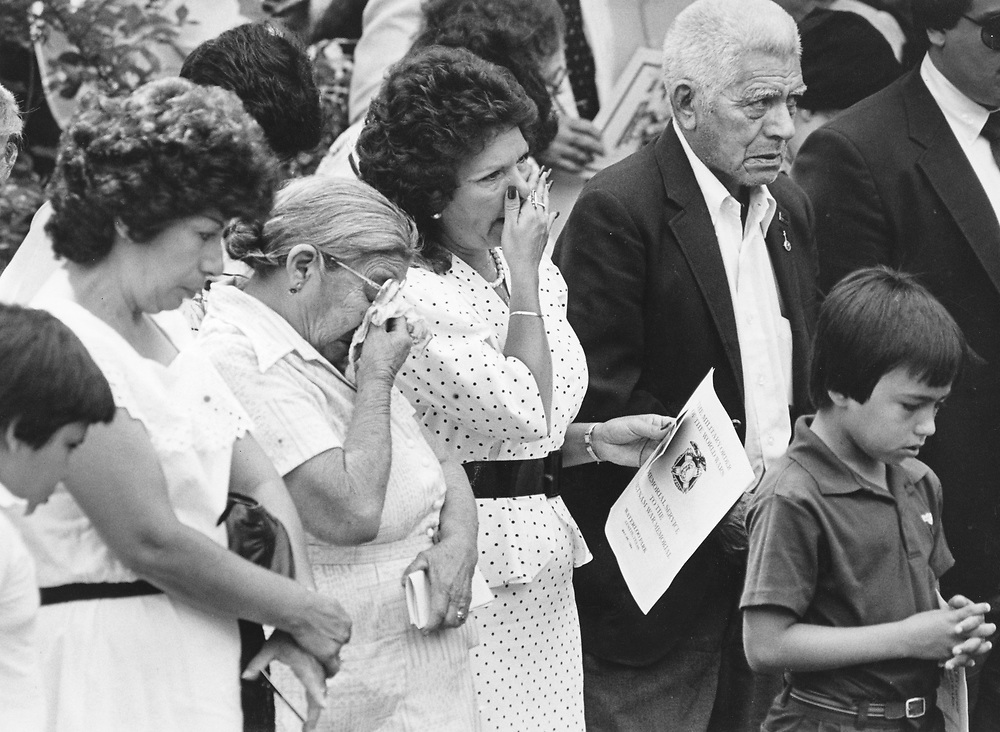 ©1983 Family of a Marine killed in the Beirut bombing of 1983 grieves at the memorial service, Austin, Texas