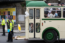 Metropolitan Police officers prepare to remove and arrest environmental activists from Extinction Rebellion who used a vintage bus to block a road junction to the south of London Bridge on the ninth day of their Impossible Rebellion protests on 31st August 2021 in London, United Kingdom. Extinction Rebellion are calling on the UK government to cease all new fossil fuel investment with immediate effect.