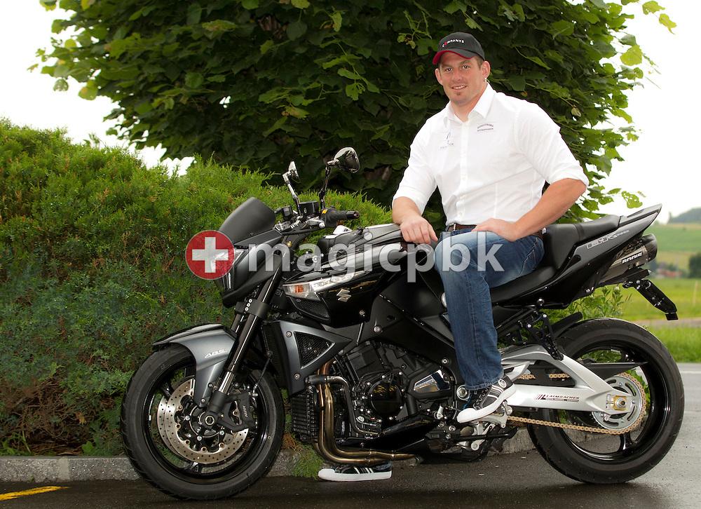 Swiss wrestling star Philipp LAIMBACHER of Switzerland poses on his motorbike for a portrait photo in Siebnen, Switzerland, Friday, May 27, 2011. (Photo by Patrick B. Kraemer / MAGICPBK)