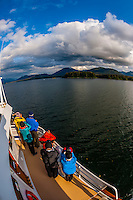 Passengers aboard the Wilderness Explorer whale watching, Port Houghton, near Frederick Sound,  Inside Passage, Southeast Alaska USA.