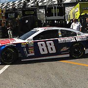 NASCAR Sprint Cup driver Dale Earnhardt Jr. (88)  leaves the garage area, during a NASCAR Daytona 500 practice session at Daytona International Speedway on Wednesday, February 20, 2013 in Daytona Beach, Florida.  (AP Photo/Alex Menendez)