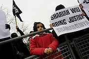 Islamic extremist women protest opposite the London Libyan embassy and demand Shariah law after the Gaddafi uprising. All are Islamic extremist women protesting opposite the London Libyan embassy demanding Shariah law after the Gaddafi uprising. Holding up their placards that ask for Shariah law for Libya and that Democracy is the path to Hellfire, the young British radicals stand behind barriers near Hyde Park Corner denouncing Colonel Gaddafi and for their views and ideology to become the way of life for the north African country.