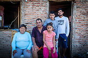 2014/11/22 – Quimili, Argentina: Catalina Barraza (56), Pedro Sousa (59), Maite Sousa (12), Franco David Sousa (14) and Silvio Daniel Sousa (23), in front of their house in in the allotment number 5 of the Guaycurú Indigenous Community. A few weeks before armed men belonging to soya groups forced entry and threaten the younger children of the family, Maite and Franco, that were alone in the house with a friend. They force them to take a few valuable belongings while the men destroyed other material stuff and told them to never come back. Due to the help of neighbours of the community the family was able to scare them away and recover their house. (Eduardo Leal)