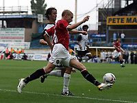Photo: Paul Thomas.<br /> Preston North End v Manchester United. Pre Season Friendly. 29/07/2006.<br /> <br /> Lee Martin of Man Utd tries to get round Danny Pugh (L).