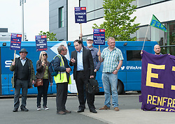 STV Anchorman John Mackay takes time to speak to Michael McShane from West College Paisley and EIS Representative as Further Education Lecturers hold a strike rally in Glasgow outside the BBC and STV studios to protest against the refusal of College Management to honour a deal on pay and conditions that was reached more than a year ago, Angie Isac | EEm Thursday 11 May 2017