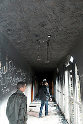 © under license to London News Pictures. 24/02/2011. People walk down a hallway in Ayesha Gadaffi's palace in Benghazi, Libya. Photo credit should read Michael Graae/London News Pictures