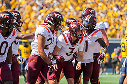 Sep 18, 2021; Morgantown, West Virginia, USA; Virginia Tech Hokies quarterback Braxton Burmeister (3) celebrates with teammates after throwing a touchdown pass during the first quarter against the West Virginia Mountaineers at Mountaineer Field at Milan Puskar Stadium. Mandatory Credit: Ben Queen-USA TODAY Sports