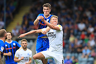 Ryan Delaney challenges Mark O'Hara during the EFL Sky Bet League 1 match between Rochdale and Peterborough United at Spotland, Rochdale, England on 11 August 2018.